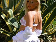 Sandra in stunning white suit white lingerie and dark stockings