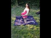 Brunette posing outdoors in nylons