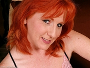 Mature Redhead Sasha Flashes Bush