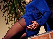 Leggy blonde posing in black nylons