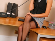 Secretary wearing a short and tight dress with and black stockings