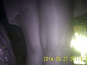 Shiny black pantyhose in night vision