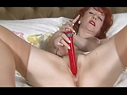 British slut Red plays with herself in stockings on a bed