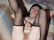 MILF in black pantyhose posing and slowly stripping