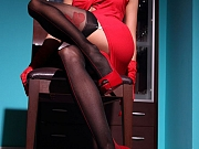 Hot MILF shows long sexy legs in black backseamed stockings