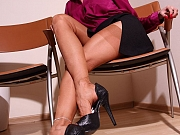 Leggy secretary in thinnest nylon stockings