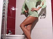 Horny pantyhosed lady in toilet