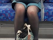Sexy woman in shiny opaque black tights