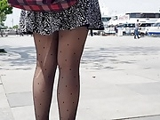Sexy girl in ripped patterned  black pantyhose