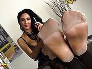 Mistress Alexya in stockings smokes a cigarette
